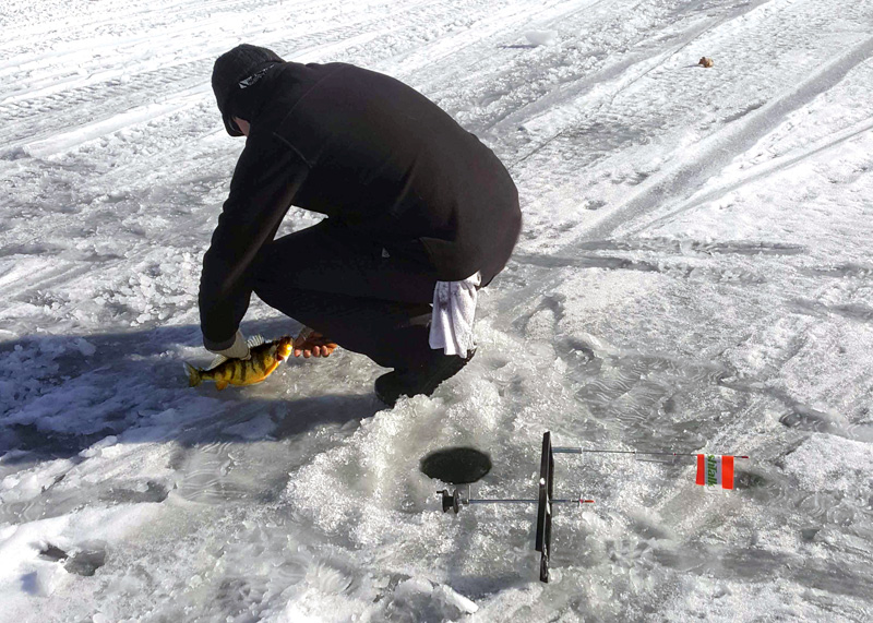 ice fishing with a tip-up
