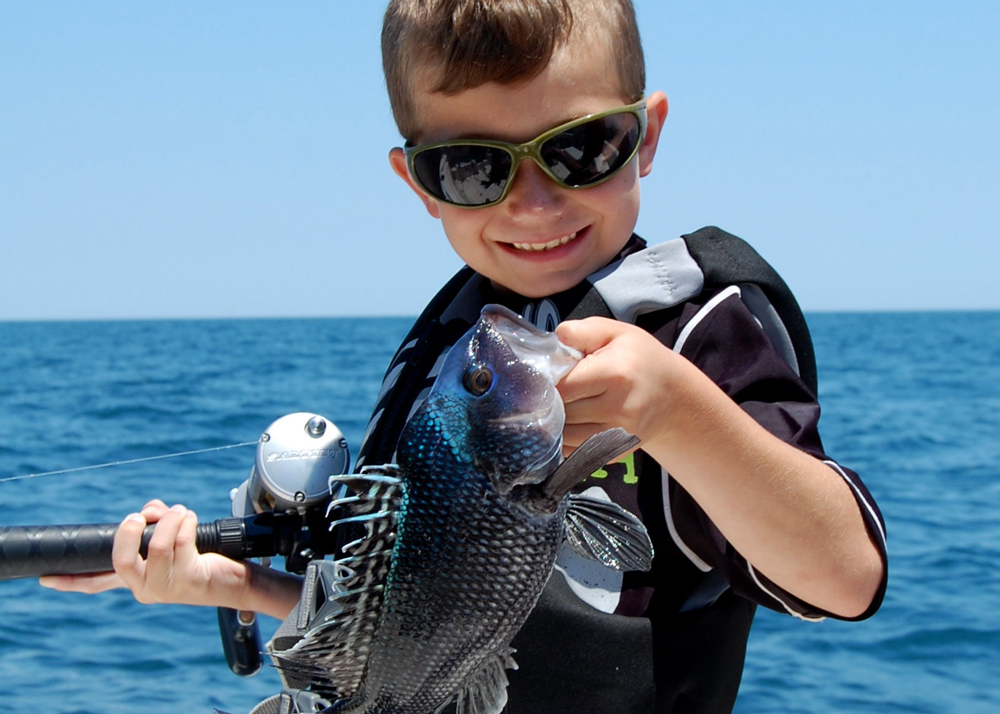 grandson fishing for sea bass