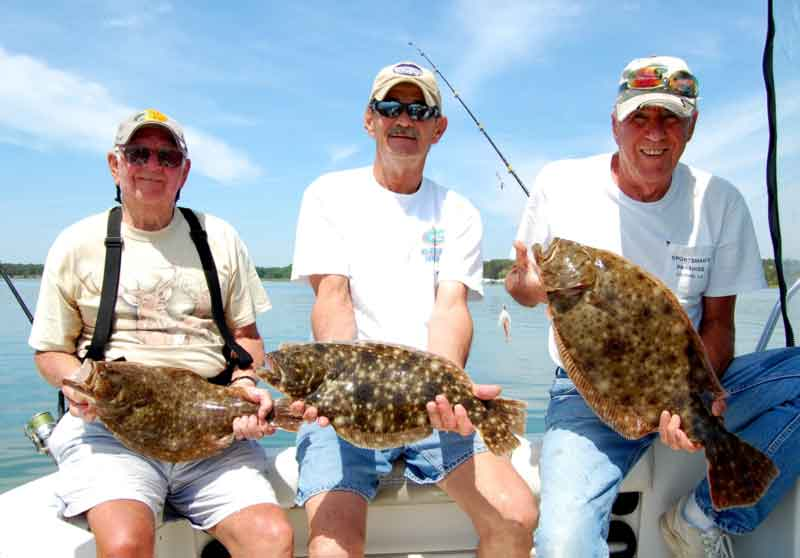 flounder fishermen with their catch