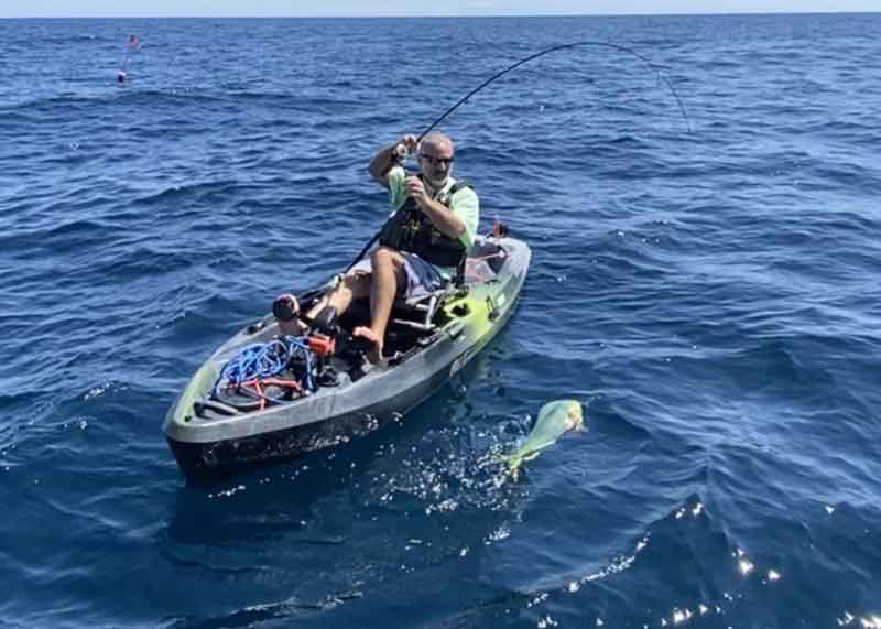 catching a dolphinfish on a kayak