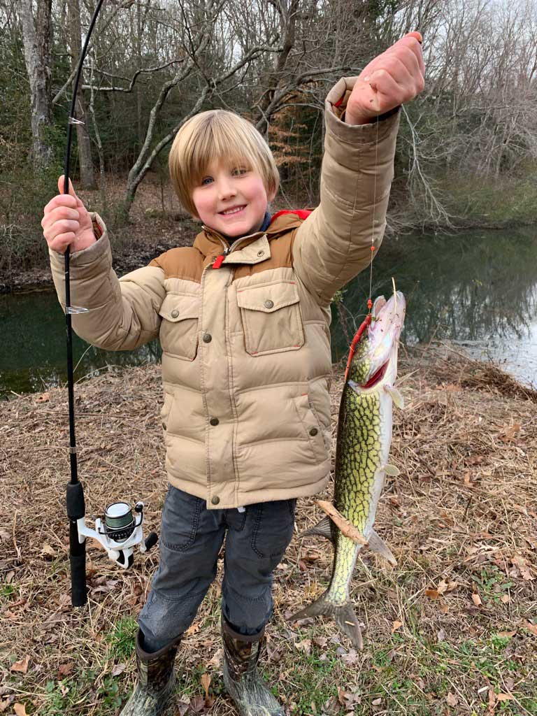 youth fishing for chain pickerel