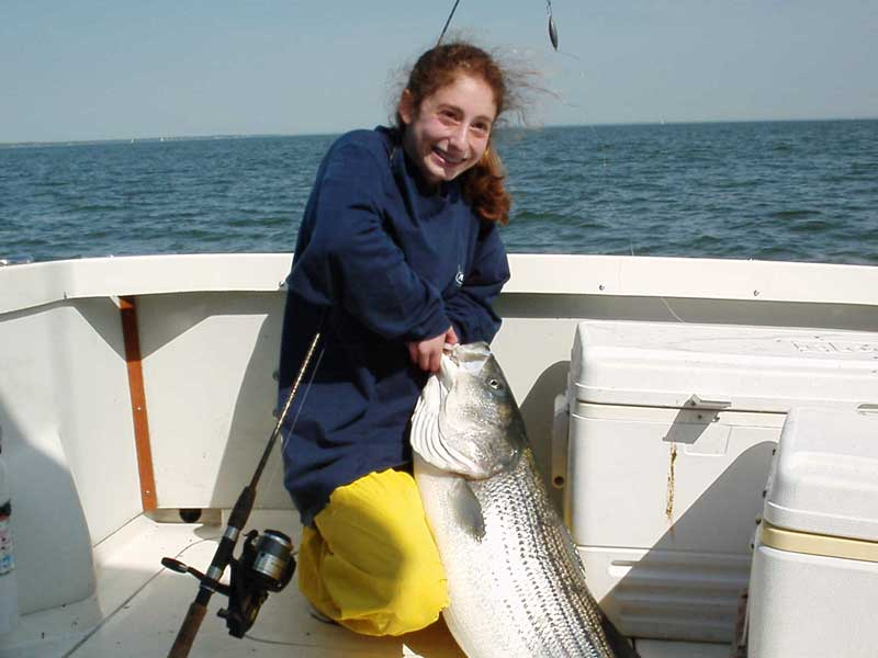 kid catches monster striper