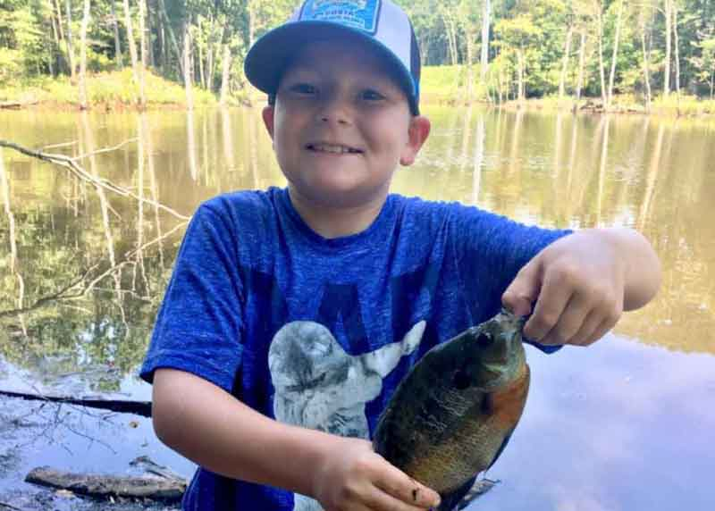 kid with a bluegill he caught