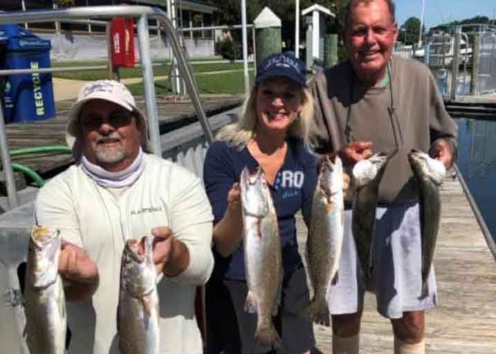 anglers with speckled trout