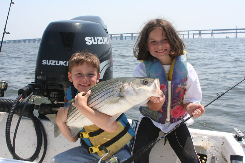 striper caught fishing in chesapeake bay with bay bridge in background