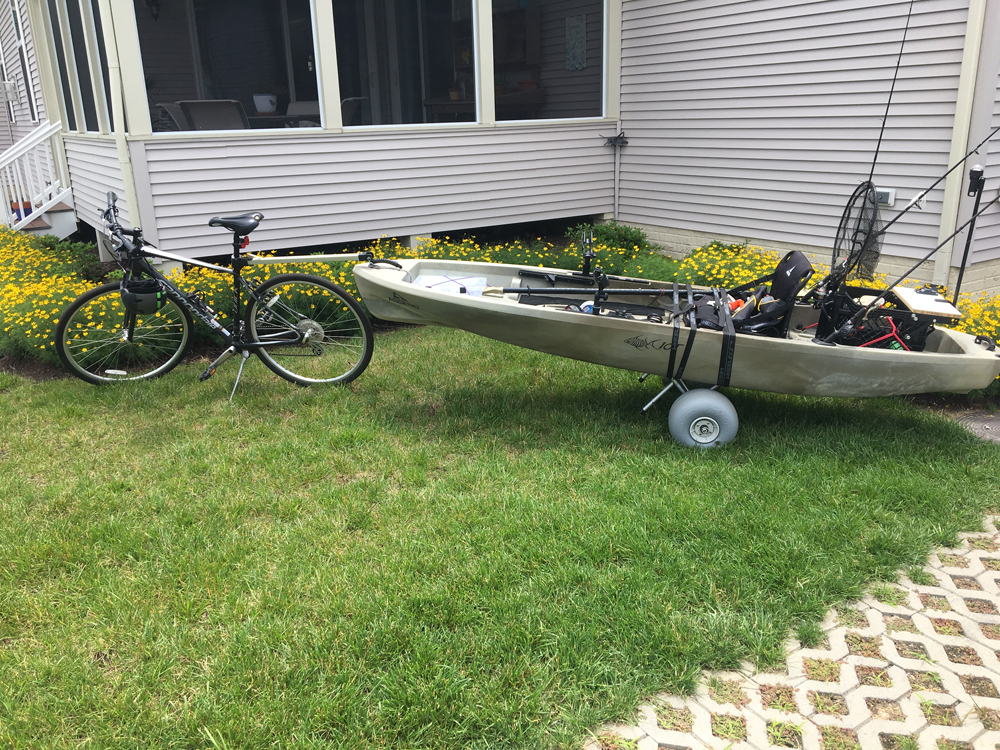 towing a kayak behind a bicycle