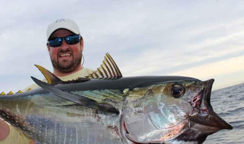 man caught a yellowfin tuna